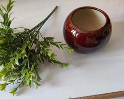 Flower pot with sticks beautiful matka shape pot with green leaves sticks