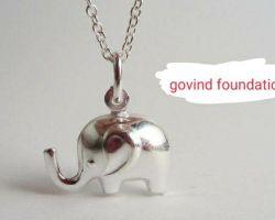 Silver elephant pendant trunk up