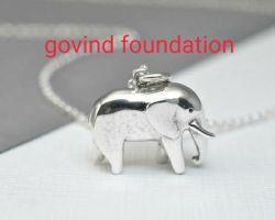 Silver elephant pendant trunk down silver elephant locket